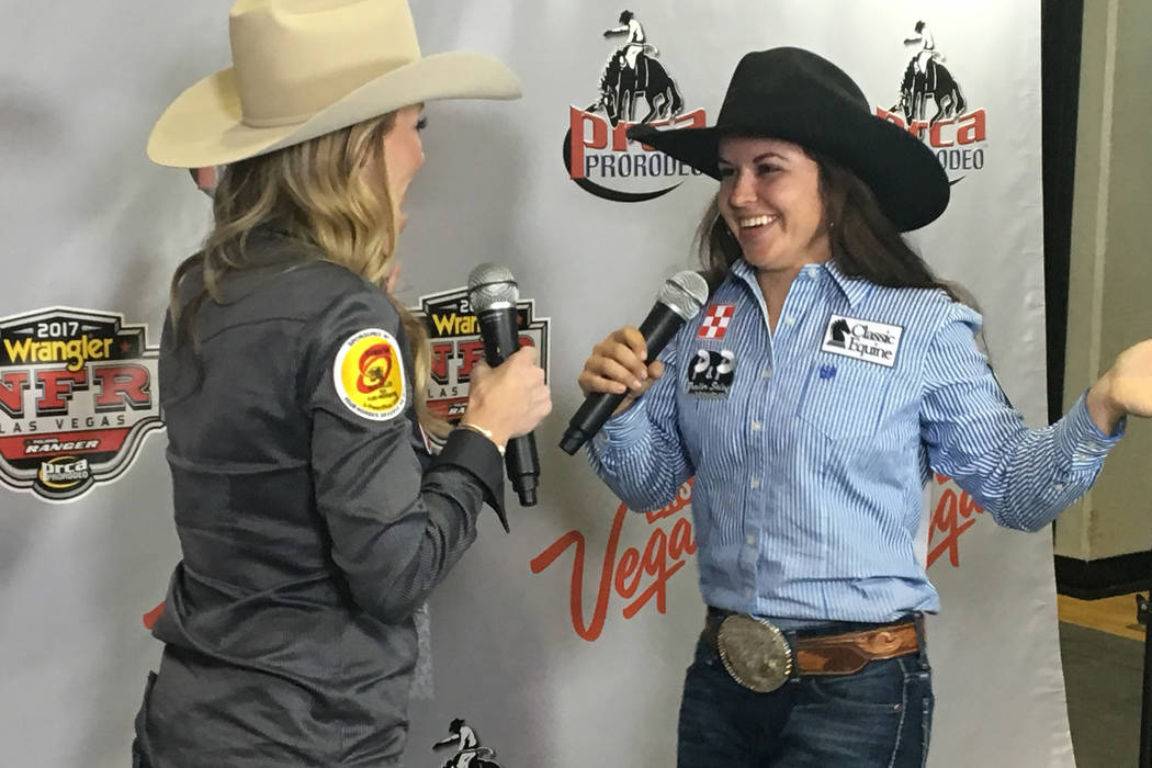 Barrel racer Hailey Kinsel does a little dance during an interview Saturday night after her arena-record-setting ride of 13.11 seconds in the third go-round of the Wrangler National Finals Rodeo.  ...