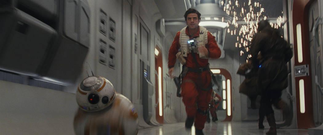 "BB-8 and Poe Dameron (Oscar Isaac) in ""Star Wars: The Last Jedi"" (Film Frames Industrial Light & Magic/Lucasfilm Ltd.)"