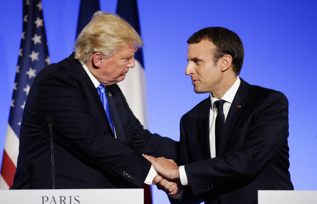 In this July 13, 2017 file photo, U.S President Donald Trump, left, shakes hands with French President Emmanuel Macron after a press conference at the Elysee Palace in Paris. Macron announced a co ...