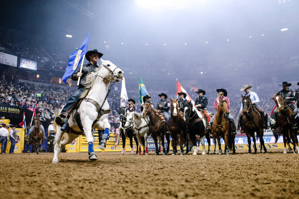 Riders enter the arena at the start of the fifth night of the 59th Wrangler National Finals Rodeo at the Thomas & Mack Center in Las Vegas, Monday, Dec. 11, 2017. Joel Angel Juarez Las Vegas R ...