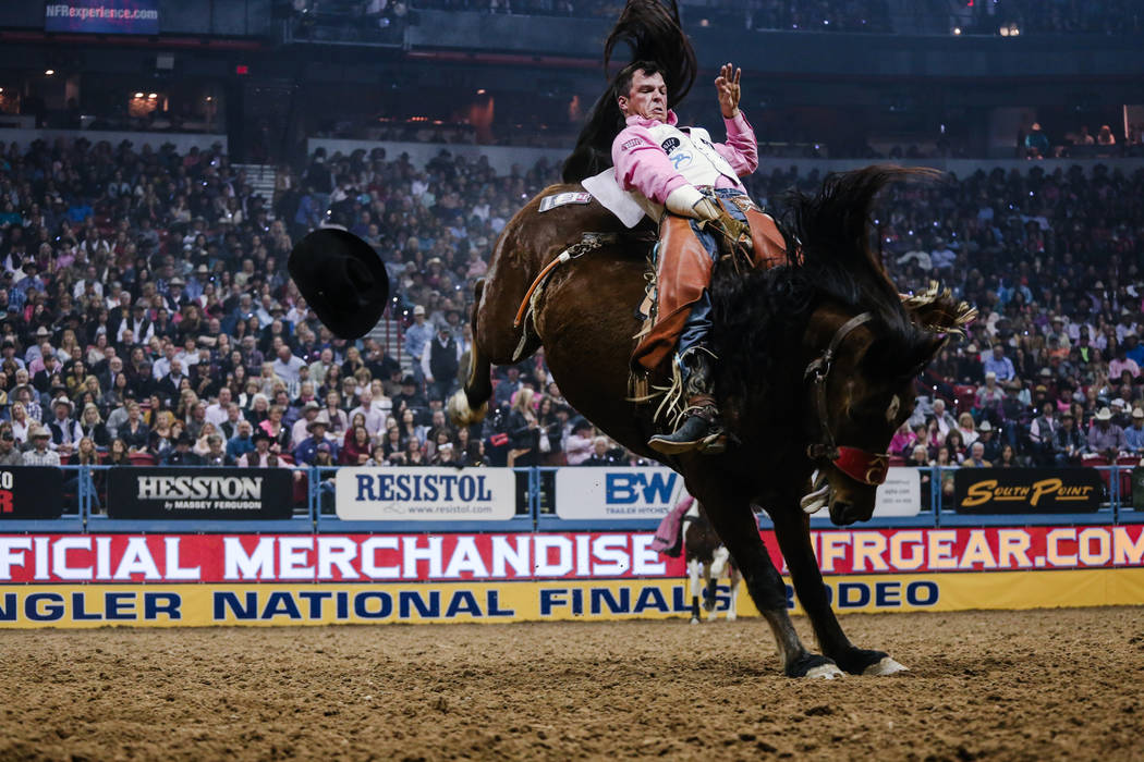Richmond Champion of The Woodlands, Texas rides Dirty Jacket during the fifth night of the 59th Wrangler National Finals Rodeo at the Thomas & Mack Center in Las Vegas, Monday, Dec. 11, 2017.  ...