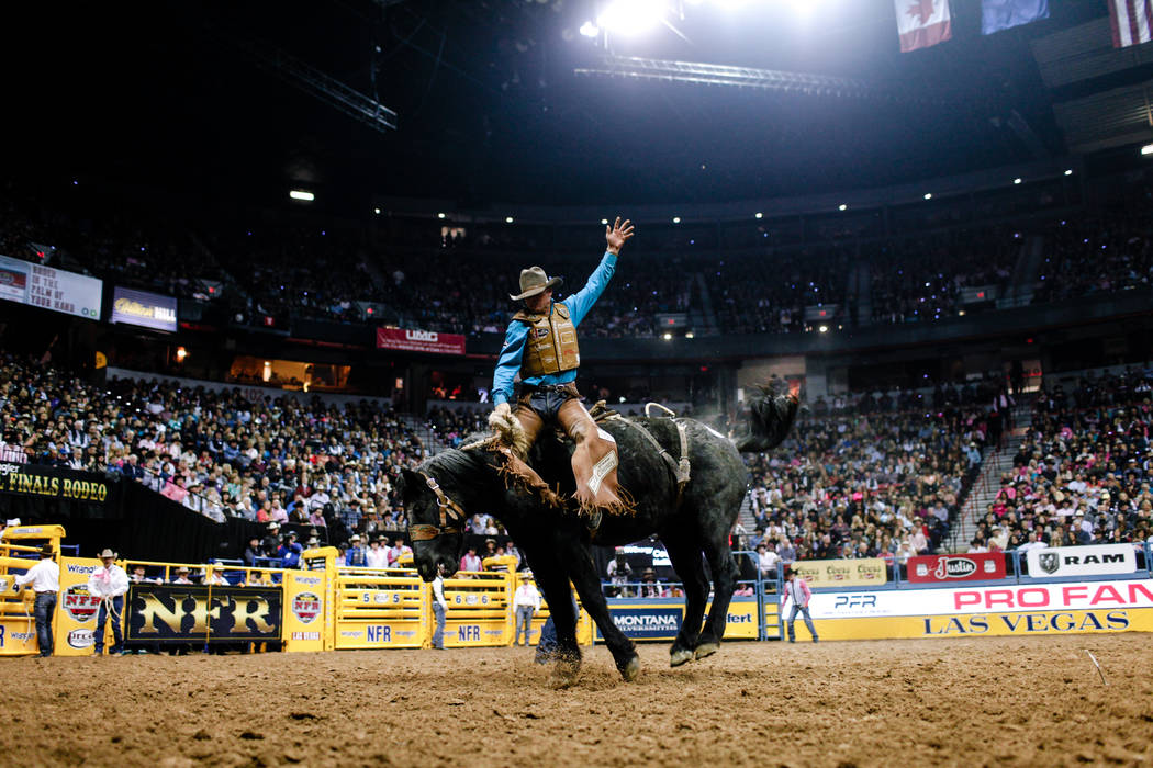 Cody DeMoss of Heflin, La. rides Spring Planting in the saddle bronc riding event during the fifth night of the 59th Wrangler National Finals Rodeo at the Thomas & Mack Center in Las Vegas, Mo ...