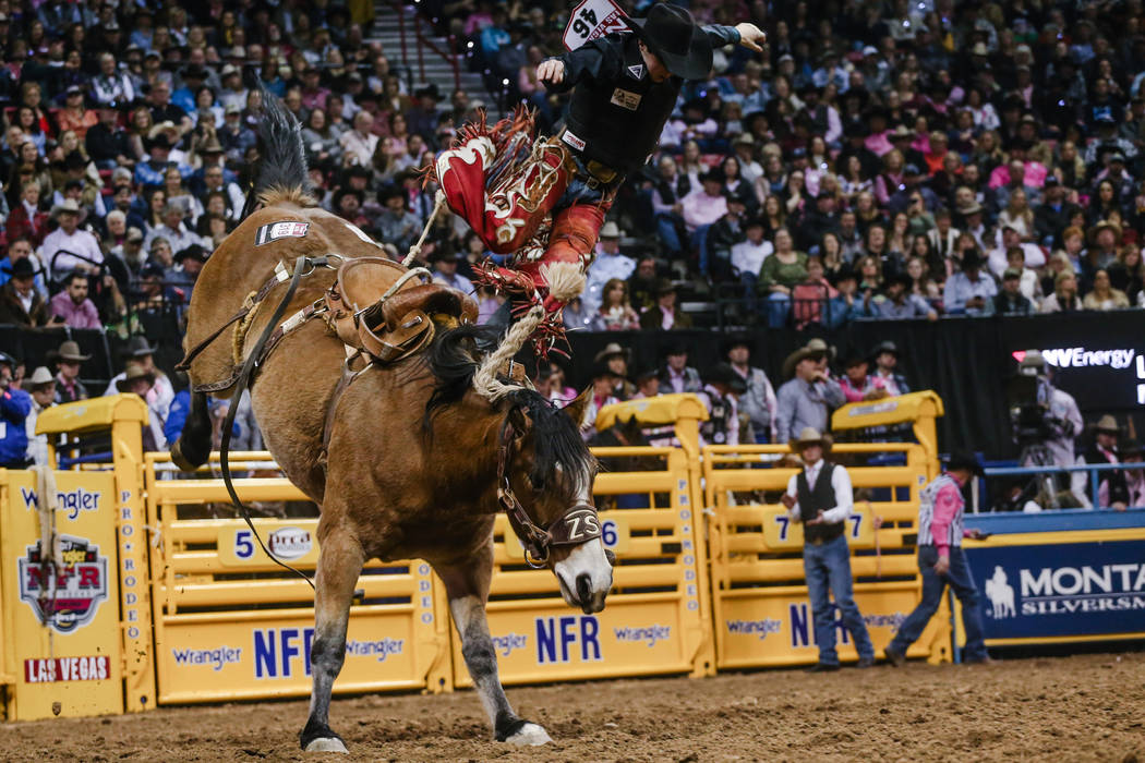 Layton Green of Meeting Creek, Alberta is bucked off of Lunatic From Hell in the saddle bronc riding event during the fifth night of the 59th Wrangler National Finals Rodeo at the Thomas & Mac ...
