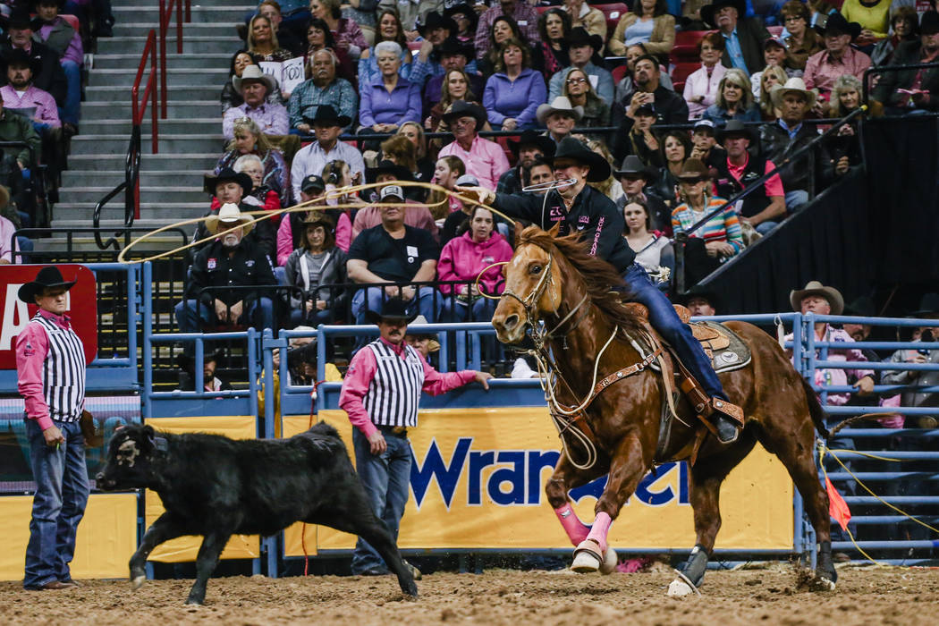 Trevor Brazile of Decatur, Texas chases down a steer in the tie-down roping event during the fifth night of the 59th Wrangler National Finals Rodeo at the Thomas & Mack Center in Las Vegas, Mo ...