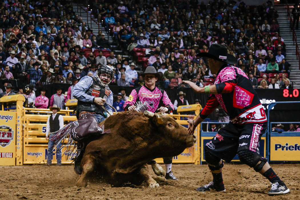 Ty Wallace of Collbran, Colo. rides Tennessee Whiskey in the bull riding event during the fifth night of the 59th Wrangler National Finals Rodeo at the Thomas & Mack Center in Las Vegas, Monda ...