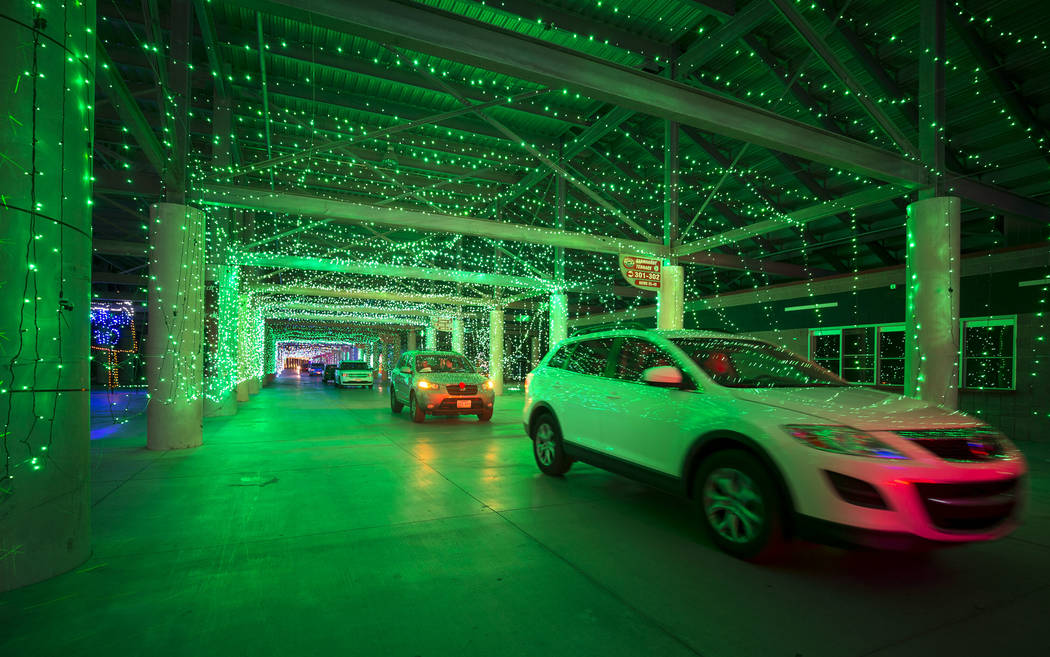Vehicles travel through the Glittering Lights show at the Las Vegas Motor Speedway in Las Vegas, Monday, Dec. 11, 2017. Richard Brian Las Vegas Review-Journal @vegasphotograph