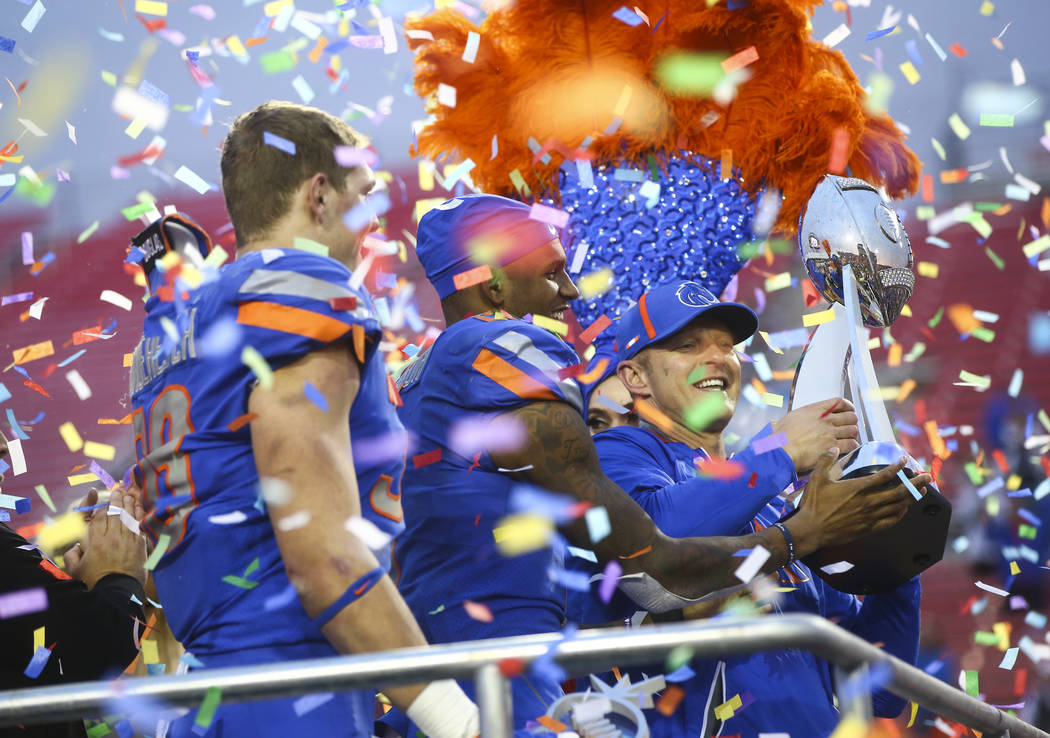 Boise State head coach Bryan Harsin, right, celebrates with players Leighton Vander Esch, left, and Cedrick Wilson after defeating Oregon in the Las Vegas Bowl at Sam Boyd Stadium in Las Vegas on  ...