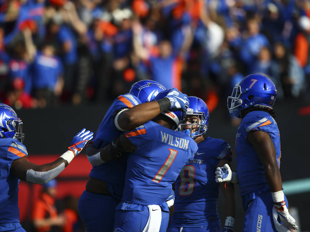 Boise State players celebrate a touchdown by Cedrick Wilson (1) during the Las Vegas Bowl game against Oregon at Sam Boyd Stadium in Las Vegas on Saturday, Dec. 16, 2017. Chase Stevens Las Vegas R ...