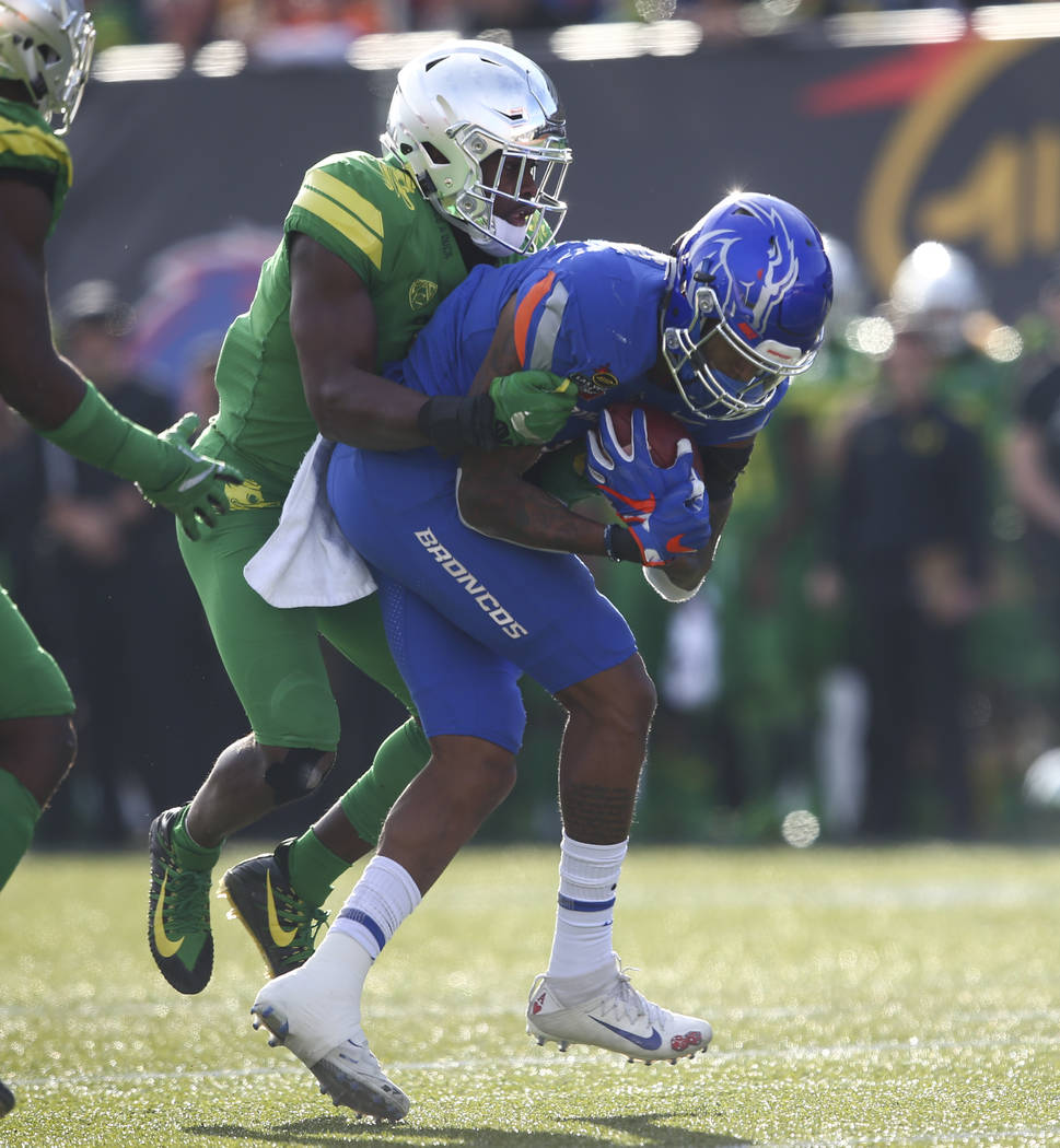 Oregon's Ugochukwu Amadi (7) takes down Boise State's Cedrick Wilson (1) during the Las Vegas Bowl at Sam Boyd Stadium in Las Vegas on Saturday, Dec. 16, 2017. Chase Stevens Las Vegas Review-Journ ...