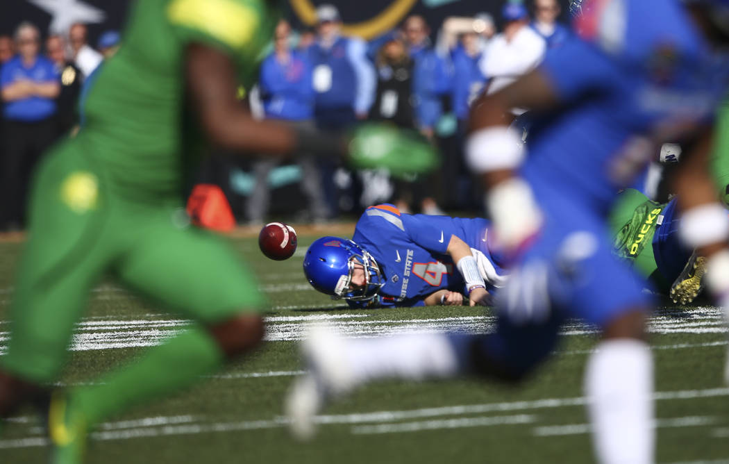 Boise State's Brett Rypien (4) gets sacked by Oregon defense during the Las Vegas Bowl at Sam Boyd Stadium in Las Vegas on Saturday, Dec. 16, 2017. Chase Stevens Las Vegas Review-Journal @cssteven ...