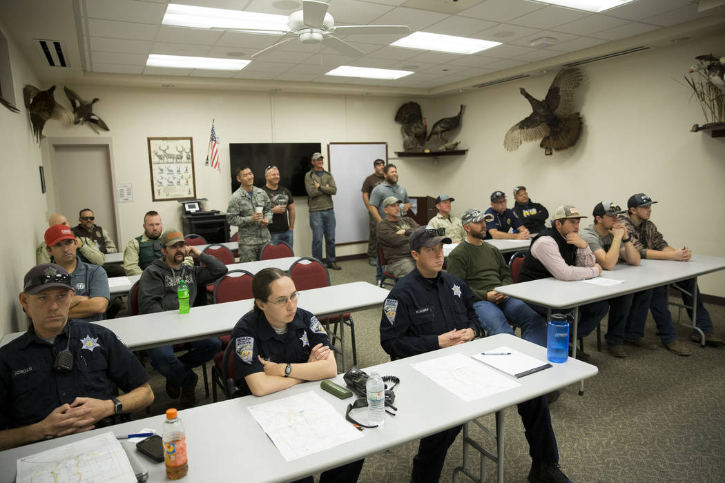 People attend an orientation at the Clark County Shooting Complex for hunters randomly picked for the annual bighorn sheep hunt inside the Nevada Test and Training Range, in Las Vegas, Friday, Dec ...