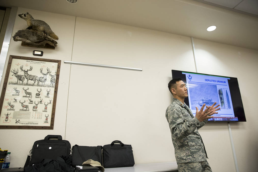 U.S. Air Force Maj. Michael Kan gives instructions during an orientation at the Clark County Shooting Complex for hunters randomly picked for the annual bighorn sheep hunt inside the Nevada Test a ...