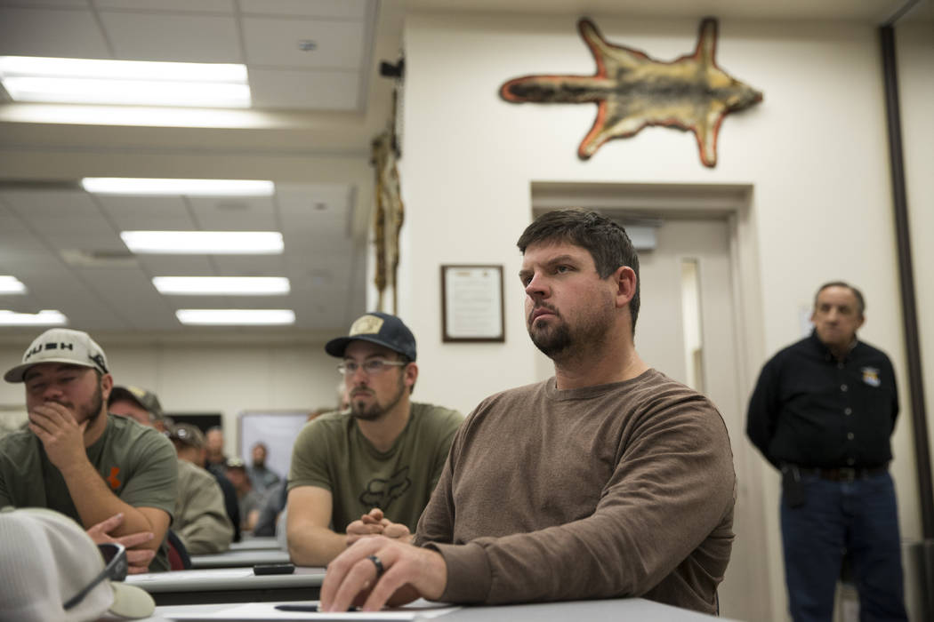 Patrick White of Reno listens during an orientation at the Clark County Shooting Complex for hunters randomly picked for the annual bighorn sheep hunt inside the Nevada Test and Training Range, in ...