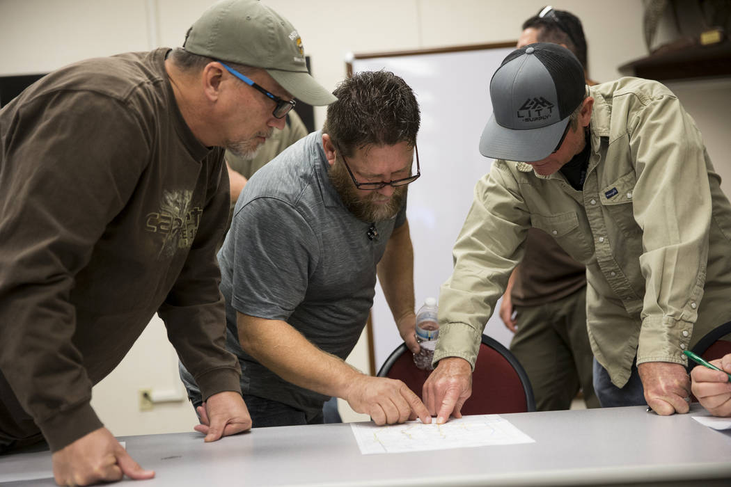 John Harris, from left, of Henderson, Dave Raynor, of Boulder City, and Darrel Leavitt, of Las Vegas, during an orientation at the Clark County Shooting Complex for hunters randomly picked for the ...