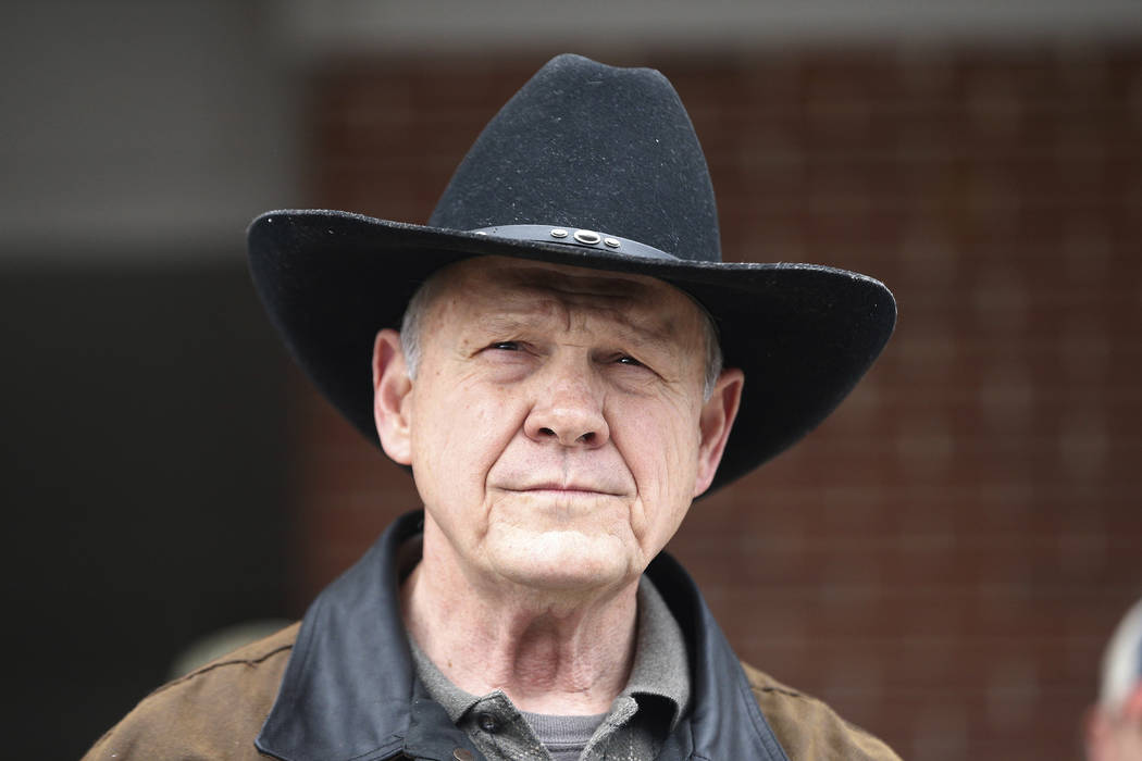 U.S. Senate candidate Roy Moore speaks to the media after he rode in on a horse to vote, Tuesday, Dec. 12, 2017, in Gallant, Ala. Alabama voters are deciding between Moore, former chief justice of ...
