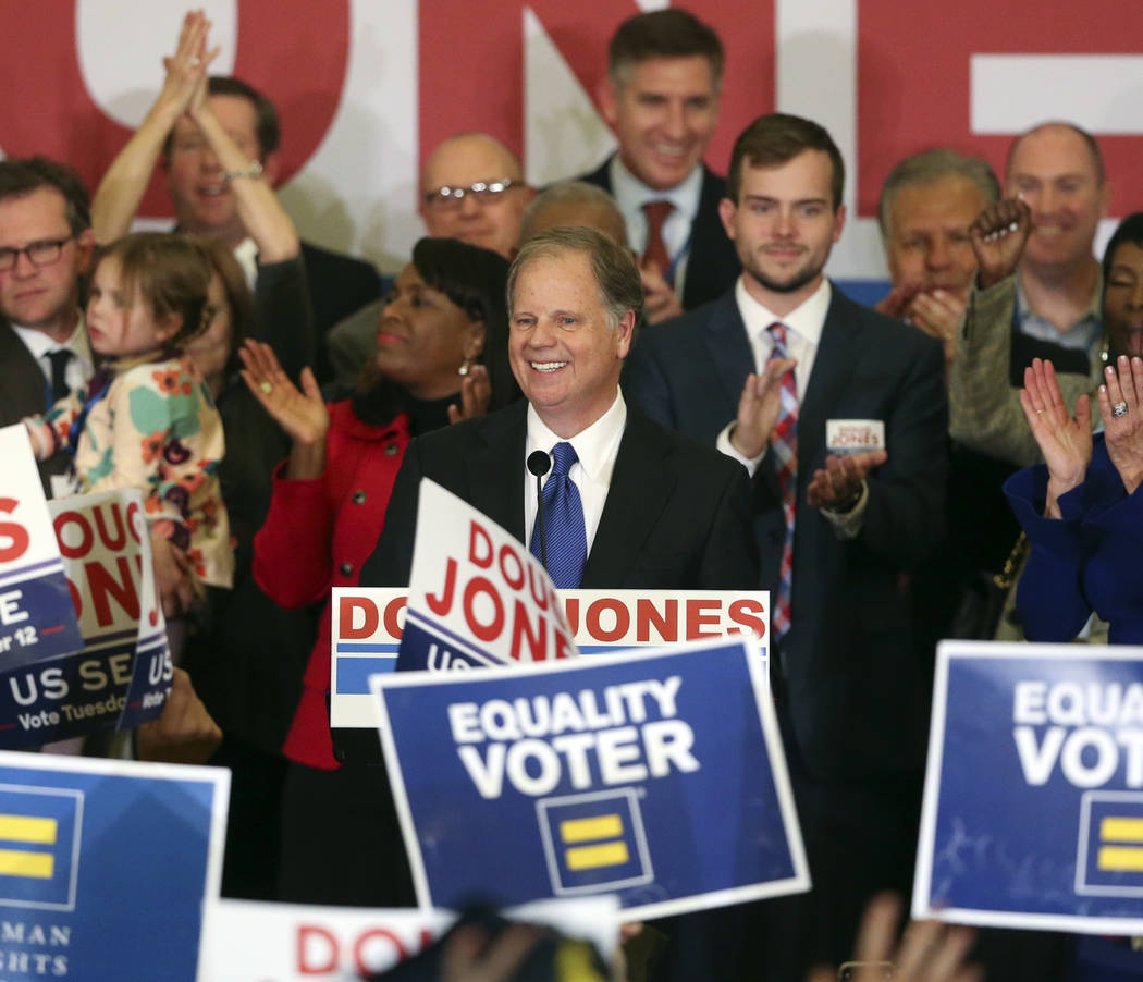 Democrat Doug Jones speaks Tuesday, Dec. 12, 2017, in Birmingham, Ala. In a stunning victory aided by scandal, Jones won Alabama's special Senate election, beating back history, an embattled Repub ...
