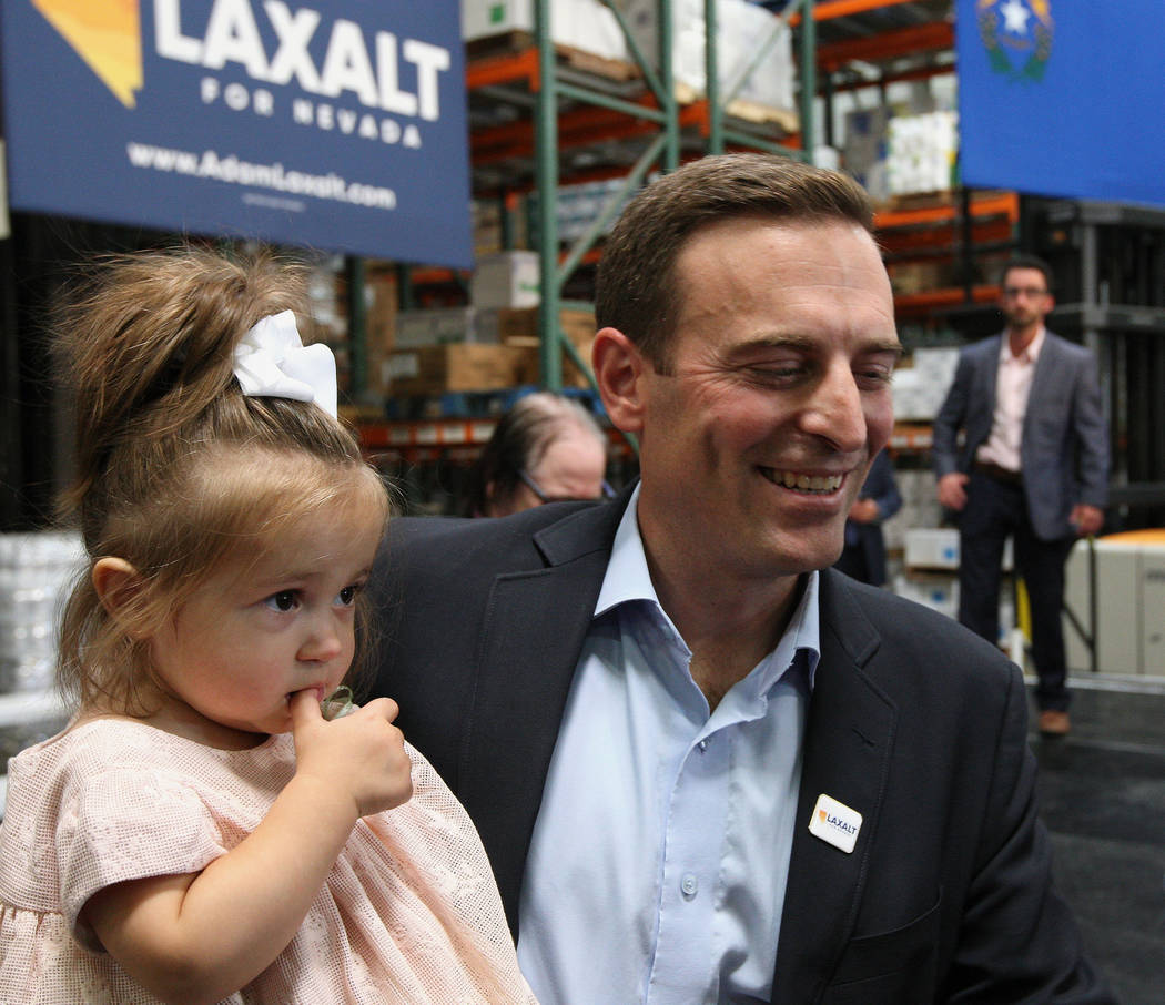 Nevada Attorney General Adam Laxalt with his daughter Isabella after announcing his bid for governor at Brady Industries's warehouse in Las Vegas, Wednesday, Nov. 1, 2017. Gabriella Benavidez Las  ...