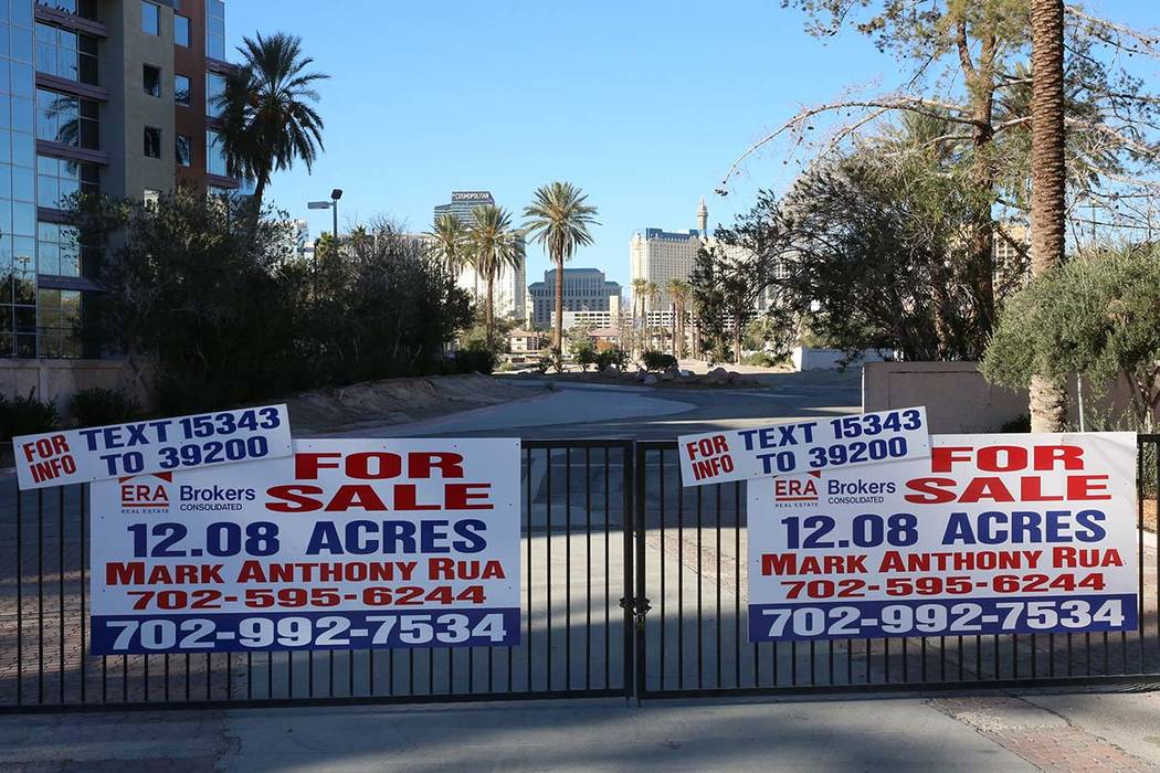For sale signs are posted at the entrance of a vacant lot at the corner of Paradise Road and Flamingo Road Wednesday, Dec. 13, 2017, in Las Vegas. A Chinese developer is trying to sell 12 acres ea ...