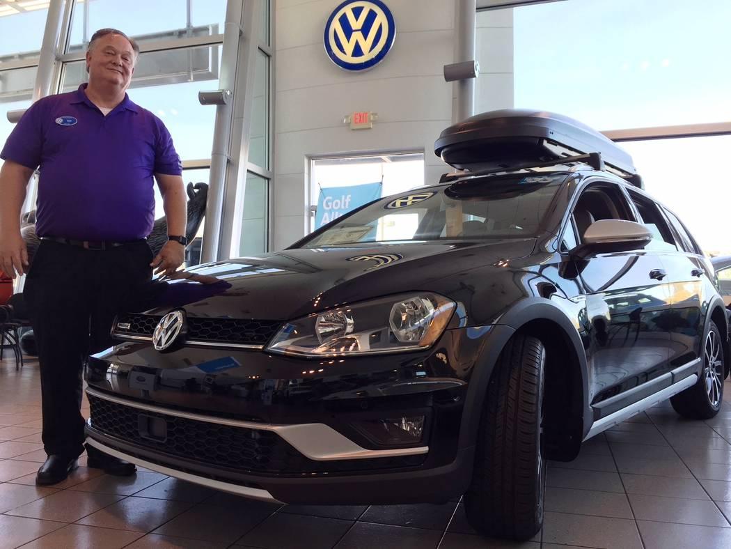Findlay Findlay Volkswagen internet manager Dan Kerrigan is seen with the 2017 Volkswagen Golf Alltrack all-wheel drive vehicle.