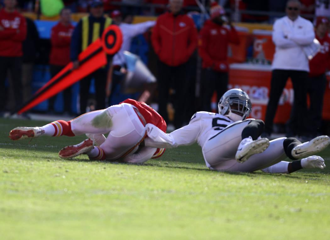 Oakland Raiders defensive end Khalil Mack (52) sacks Kansas City Chiefs quarterback Alex Smith (11) during the first half of a NFL game in Kansas City, Mo., Sunday, Dec. 10, 2017. Heidi Fang Las V ...