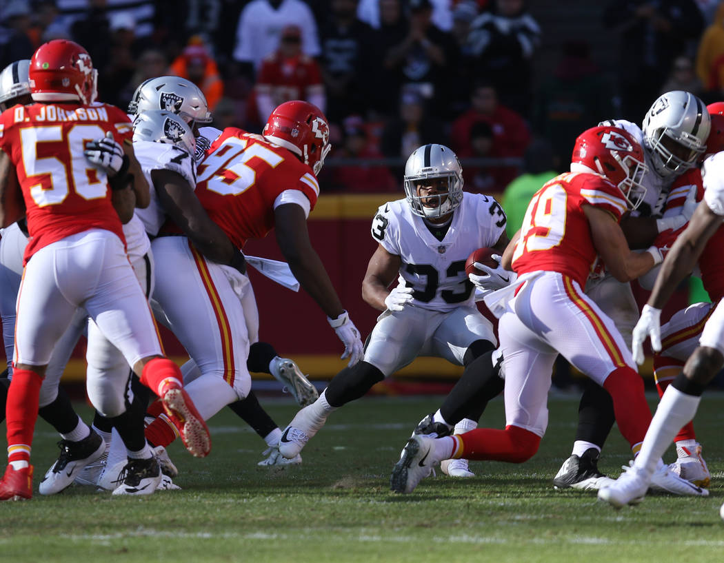 Oakland Raiders running back DeAndre Washington (33) runs against the Kansas City Chiefs during the first half of a NFL game in Kansas City, Mo., Sunday, Dec. 10, 2017. Heidi Fang Las Vegas Review ...