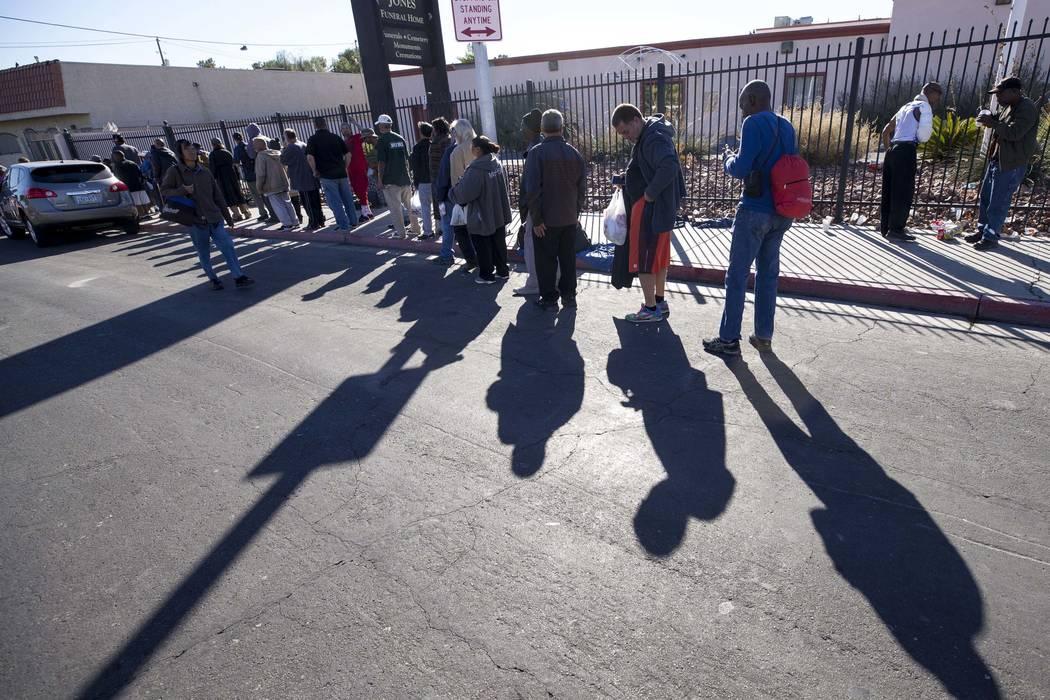A line homeless people wait for food handouts on Foremaster Lane between Las Vegas Blvd. and Main Street in Las Vegas, Wednesday, Nov. 22, 2017. Richard Brian Las Vegas Review-Journal @vegasphotograph