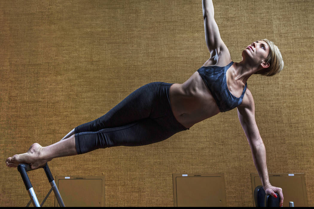 """Delphine Perroud is a nutritionist and pilates instructor who was previously a lead dancer in """"Le Reve."""" Photo taken on Friday, Dec. 15, 2017, at Life Time Athletic Club, in Henderso ..."""