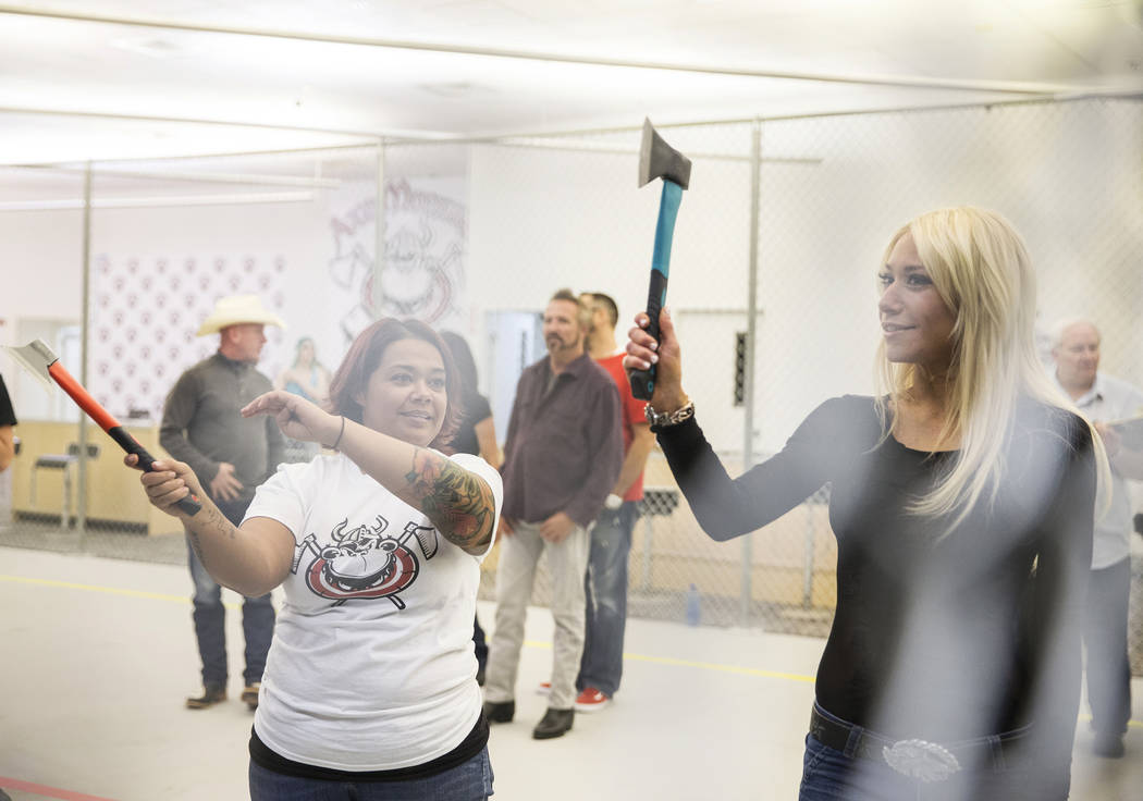 "Instructor Erica Jensen, left, gives throwing tips to Lydia Ansel, right, at Axe Monkeys Vegas on Wednesday, Feb. 1, 2017, in Las Vegas. ""I've thrown knives and ninja stars before,&qu ..."