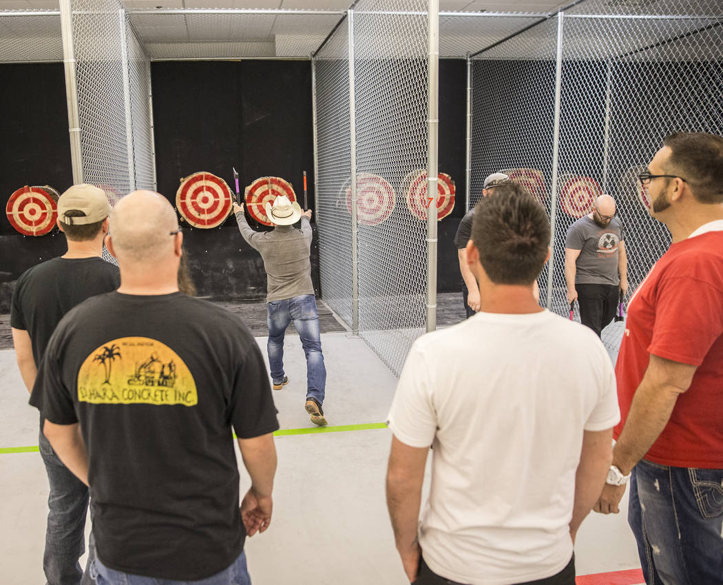 Jared Lowry practices throwing axes at Axe Monkeys Vegas on Wednesday, Feb. 1, 2017, in Las Vegas. The new business is slated to open in late February, offering customers the ability to throw axes ...