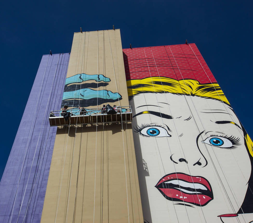 A mural by contemporary street artist D*face is shown in progress on the side of the Plaza hotel-casino in downtown Las Vegas on Wednesday, Feb. 8, 2017. (Miranda Alam/Las Vegas Review-Journal) @m ...