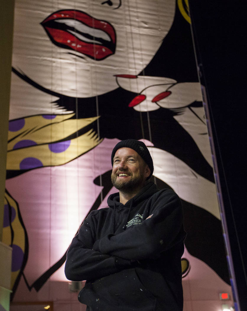 Contemporary street artist D*face poses in front of his new mural on the side of the Plaza hotel-casino in downtown Las Vegas on Wednesday, Feb. 8, 2017. (Miranda Alam/Las Vegas Review-Journal) @m ...