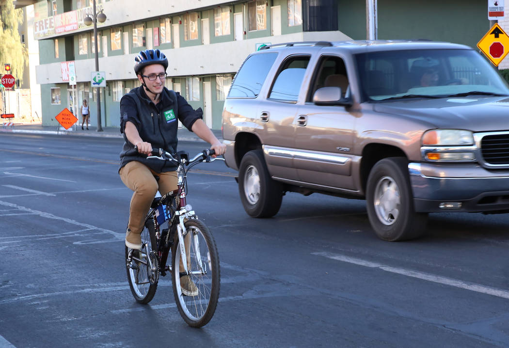 Dan Duggan, software engineer at Charles River Analytics, demonstrates bicycling safety technology at the corner of Seventh Street and Carson Street on Wednesday, Dec. 13, 2017, in Las Vegas. Tech ...