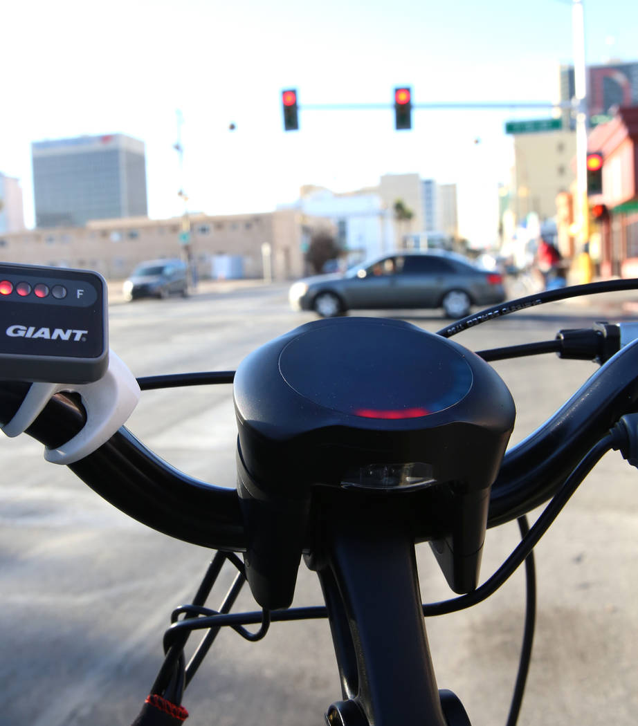 A red light displayed on a prototype bicycle notifies riders of an upcoming traffic signal as software developers from Charles River Analytics demonstrate bicycling safety technology at the corner ...