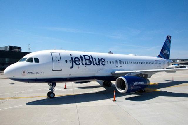A JetBlue plane sits on an unidentified tarmac. (CNN)