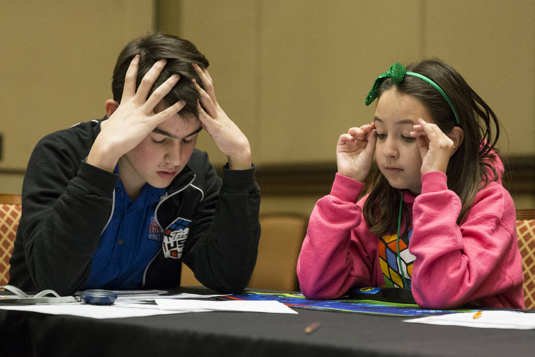 Calvin Brauer, 15, left, of Baltimore, Md., and Eliana Au, 10,  of Henderson, during the word memory competition at SkillCon inside the Rio Convention Center in Las Vegas, Saturday, Dec. 16, 2017. ...