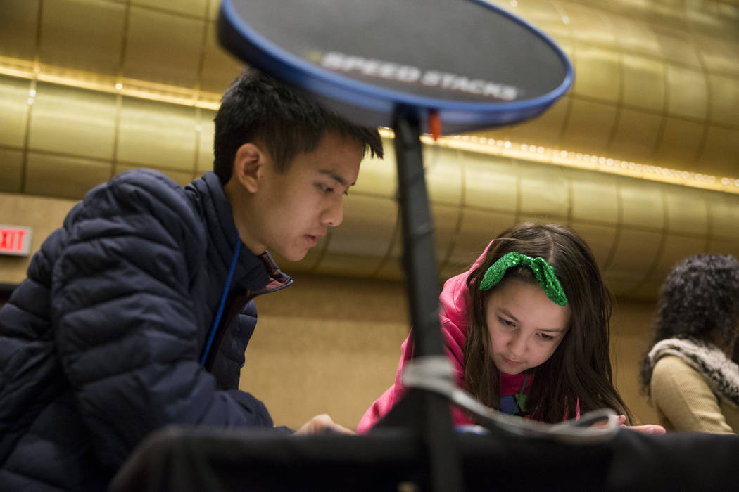 UC Berkley student Riley Woo, 20, left, and Eliana Au, 10,  of Henderson, during the word memory competition at SkillCon inside the Rio Convention Center in Las Vegas, Saturday, Dec. 16, 2017. Eri ...