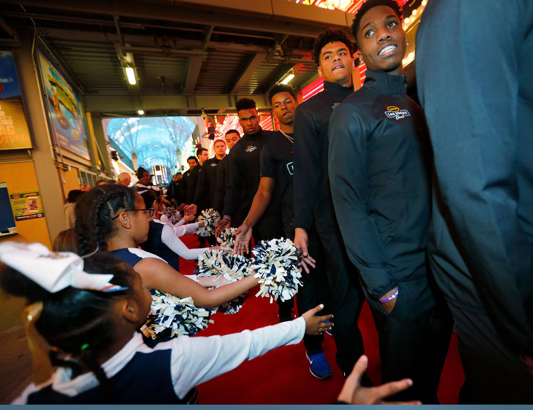 Boise State Broncos players and staff members arrive at the Las Vegas Bowl welcome reception at Fremont Street Experience in Las Vegas, Wednesday, Dec. 13, 2017.  Boise State Broncos and Oregon Du ...