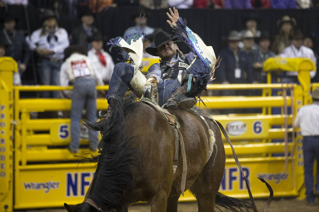 R.C. Landingham of Hat Creek, California takes part in the bareback competition in the sixth go-round of the Wrangler National Finals Rodeo, Tuesday, Dec. 12, 2017, at the Thomas & Mack Center ...