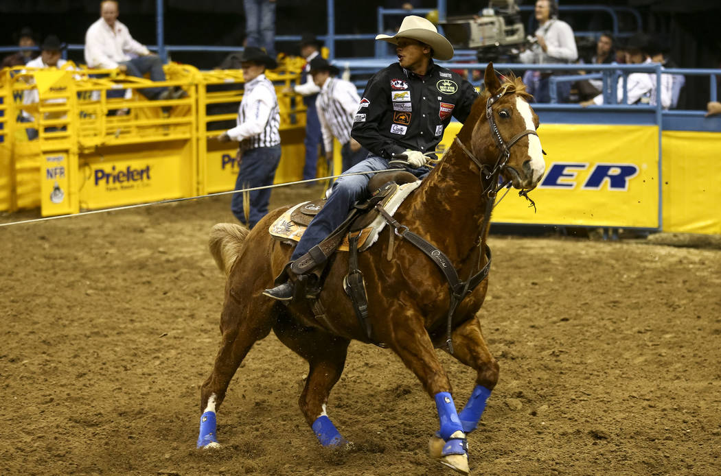 Jr. Dees and Tyler McKnight, not shown, takes part in the team roping competition in the sixth go-round of the Wrangler National Finals Rodeo, Tuesday, Dec. 12, 2017, at the Thomas & Mack Cent ...