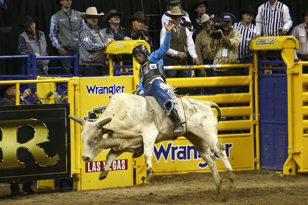 Joe Frost of Randlett, Utah takes part in the bull riding competition in the sixth go-round of the Wrangler National Finals Rodeo, Tuesday, Dec. 12, 2017, at the Thomas & Mack Center in Las Ve ...