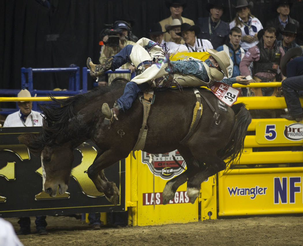 J.R. Vezain of Cowley, Wyoming takes part in the bareback riding competition in the sixth go-round of the Wrangler National Finals Rodeo, Tuesday, Dec. 12, 2017, at the Thomas & Mack Center in ...