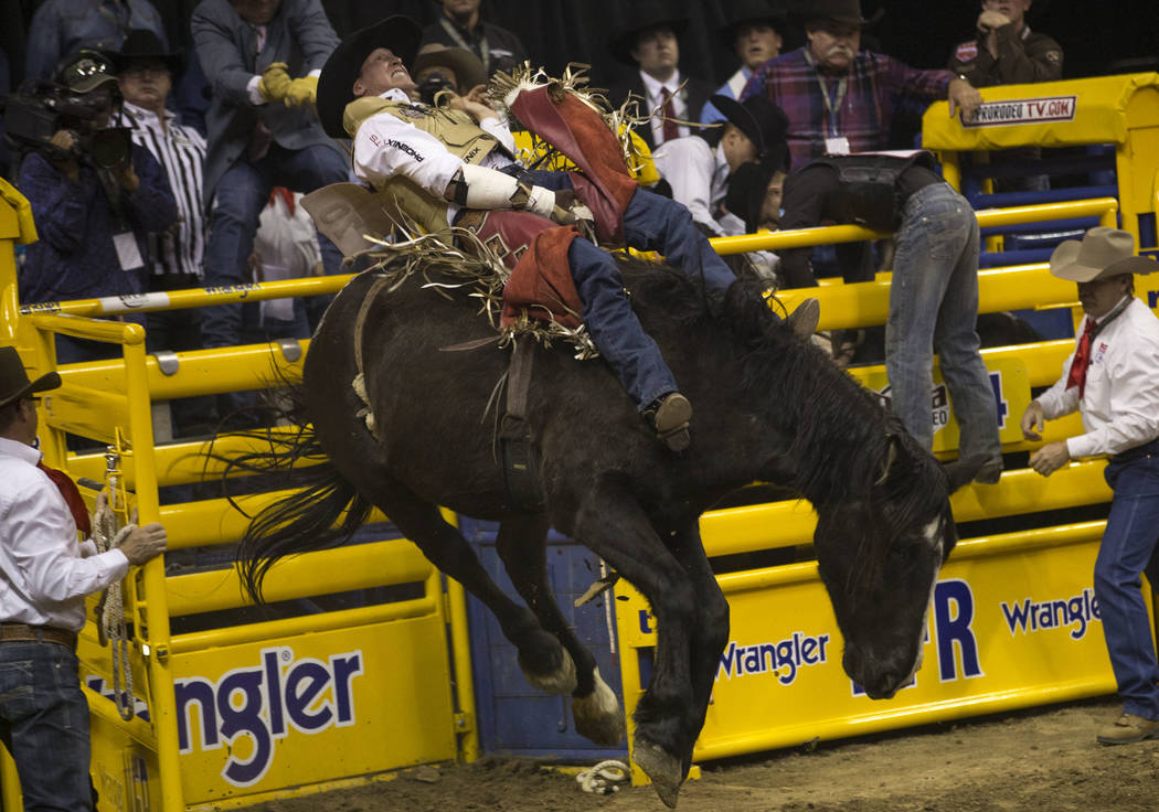 Ty Breuer of Mandan, North Dakota takes part in the bareback riding competition in the sixth go-round of the Wrangler National Finals Rodeo, Tuesday, Dec. 12, 2017, at the Thomas & Mack Center ...