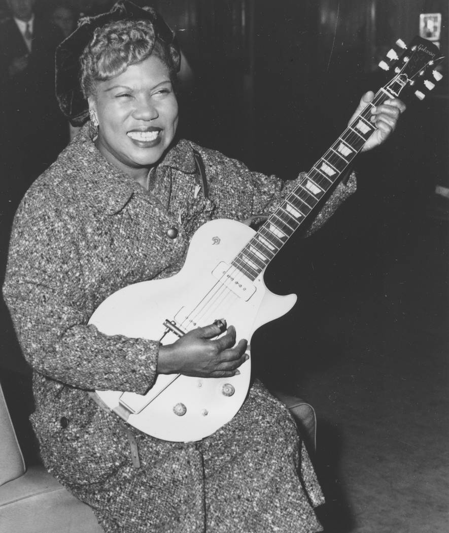 In this Nov. 21, 1957, file photo, Sister Rosetta Tharpe, guitar-playing American gospel singer, gives an inpromptu performance in a lounge at London Airport, following her arrival from New York.  ...