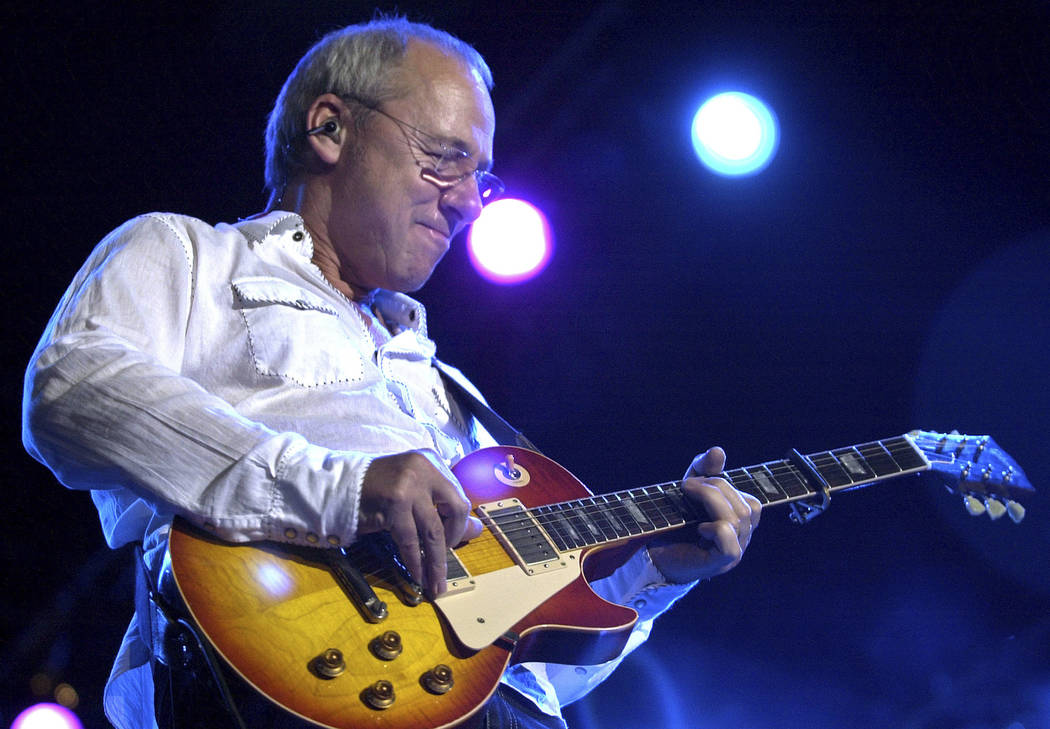 In this March 5, 2005 file photo, Dire Straits lead guitarist Mark Knopfler performs at a concert in Bombay, India. English rockers Dire Straits will be inducted into the Rock and Roll Hall of Fam ...