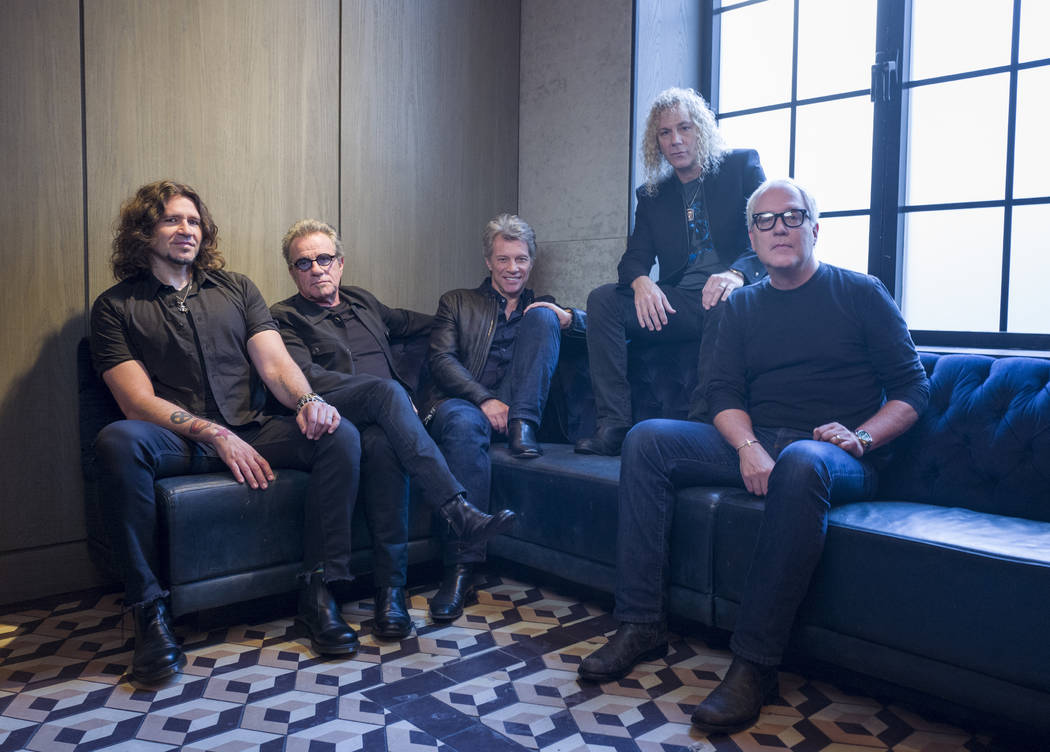 In this Oct. 19, 2016 file photo, members of Bon Jovi from left, Phil X, Tico Torres, Jon Bon Jovi, David Bryan and Hugh McDonald pose for a portrait in New York. The band will be inducted into th ...
