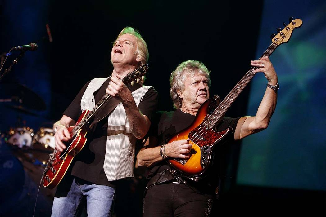 In this Aug. 20, 2009, file photo, guitarist Justin Hayward, left, and bassist John Lodge of The Moody Blues perform at Radio City Music Hall in New York. The Moody Blues will be inducted to the R ...