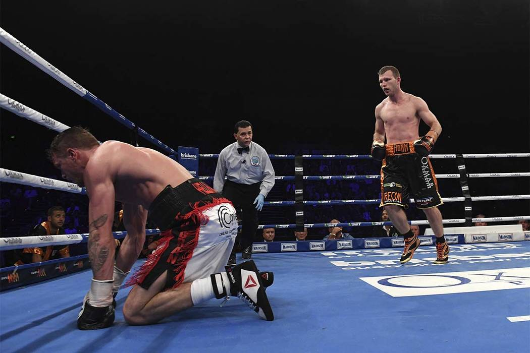 Jeff Horn of Australia, right, looks at Britain's Gary Corcoran as he takes a fall during their WBO Welterweight title fight in Brisbane, Australia, Wednesday, Dec.13, 2017. Horn won the fight by  ...