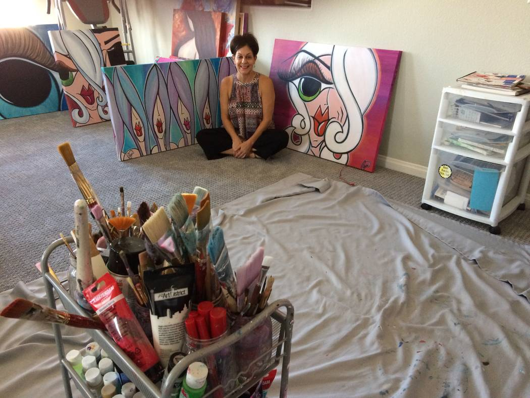 Caryn Citron talks Sept. 12, 2017, about how she turned to painting after her stroke and says focusing her mind on her art has helped her alleviate pain. She suffered a concussion which led to hav ...