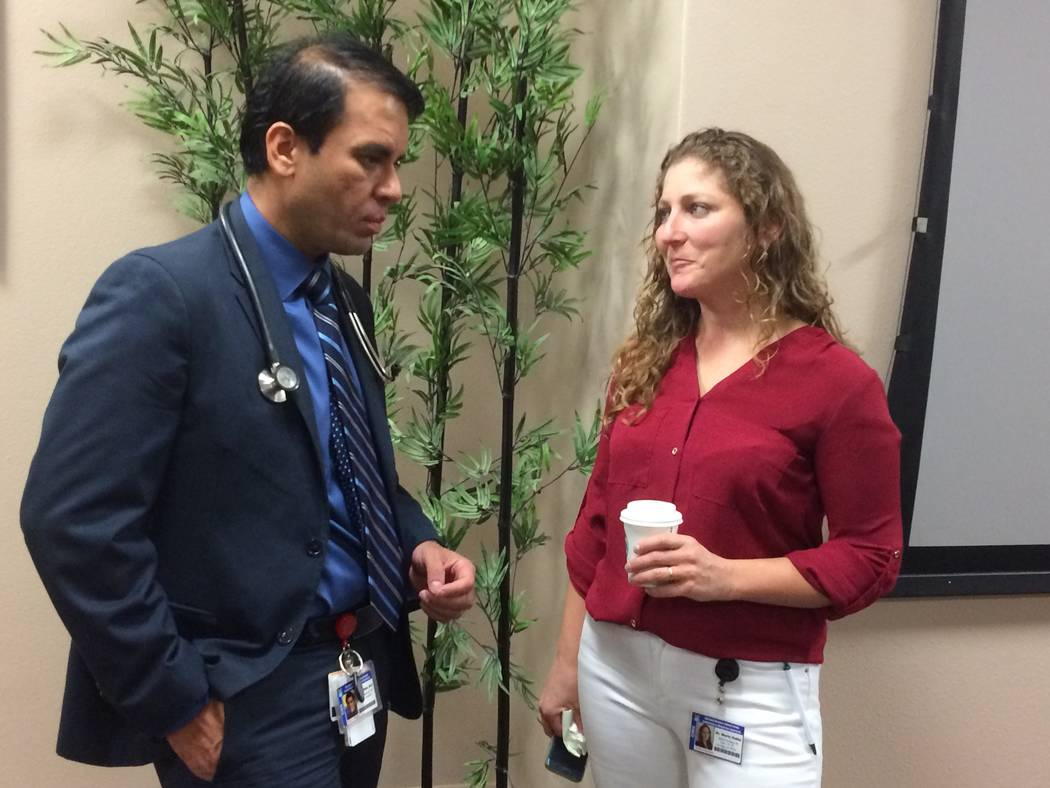 Doctors Dhaval Shah and Maria Nabbi discuss a patient's treatment Sept. 21, 2017, at his facility Clinical Infectious Diseases Specialist - CIDS, 2435, Fire Mesa St., Suite 120. Shah grew up in In ...