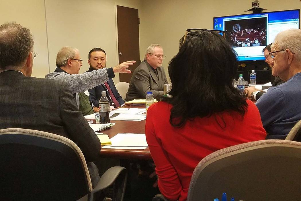Michael Bluestein makes a point to state Gaming Control Board hearing officer Chan Langsavath in a player dispute hearing at the Gaming Control Board offices at the Sawyer Building in Las Vegas on ...